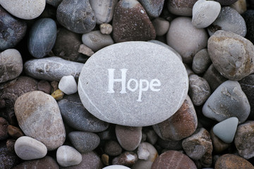Stone with the word Hope on stone background