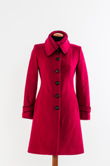 Red coat with black buttons on white background