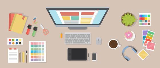 Web designer desk mockup. Desk with computer screen, tablet and drawing  tools.