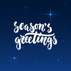 Season's greetings -lettering Christmas and New Year holiday calligraphy phrase isolated on the shining background with stars. Fun brush ink typography for photo overlays, t-shirt print, poster design