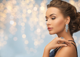 woman in evening dress with diamond earring