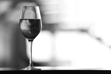 Black-and-white photo of wine glass on table