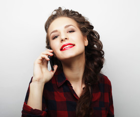 woman talking on phone over white background