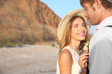 Young happy couple on cliff background