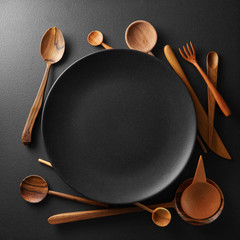 setting empty plate and wooden cutlery
