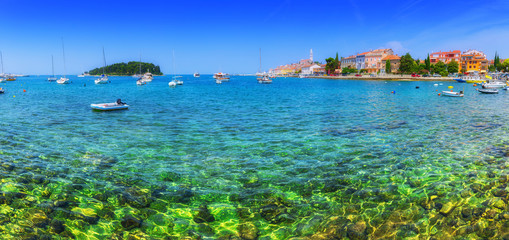 Foto op Canvas Stad aan het water Wonderful romantic old town at Adriatic sea. Boats and yachts in harbor crystal clear turquoise water at magical summer. Rovinj. Istria. Croatia. Europe.