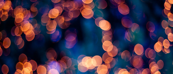 Christmas lights blurred background -  orange and blue. Wall mural
