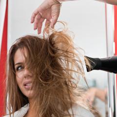Drying hair. Drying female's long hair