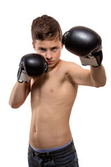 Actor athlete brunette boy with boxing gloves on white background