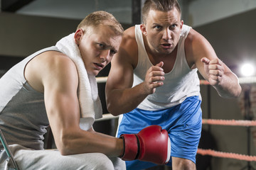 Trainer motivating professional boxer