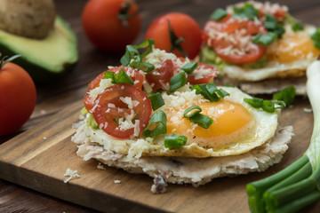 Huevos rancheros tostadas with avocado salsa