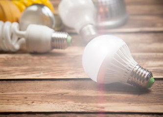 LED bulb and Incandescent bulbs on the wooden