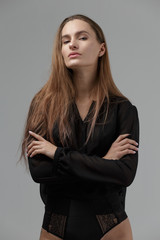 Fashion style model in black shirt and underwear posing in the s