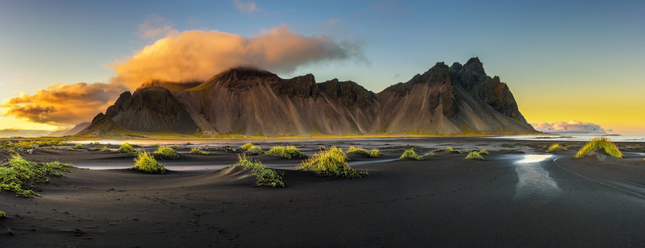 Sunset above  Vestrahorn and its black sand beach in Iceland