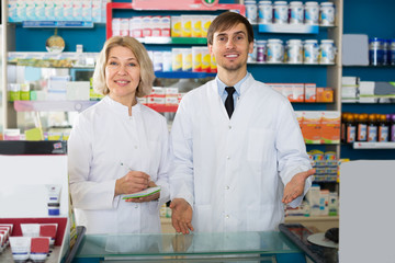 technicians working in chemist shop