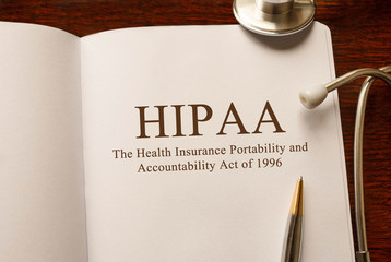 Page with HIPAA (The Health Insurance Portability and Accountability Act of 1996) on the table with stethoscope, medical concept