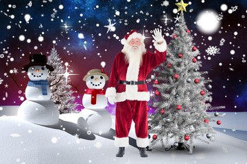 Santa claus waving his hand during christmas time