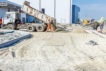Dump truck is unloading soil