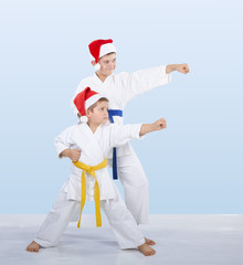 Cheerful sportsmen are training beat punch arm