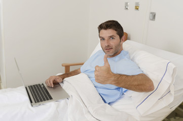 patient in hospital suffering disease and working at the clinic bed with laptop computer smiling happy