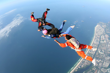 Skydiving group over the coast