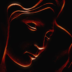 silhouette of Virgin Mary on black background