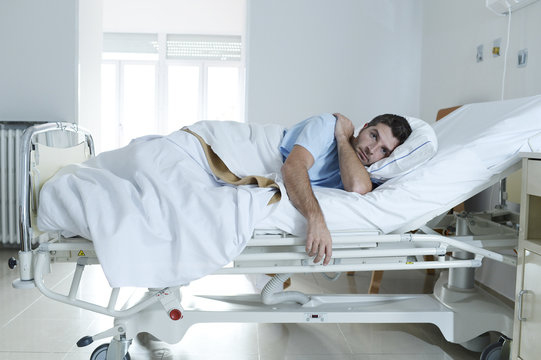 desperate man at hospital bed alone sad and devastated suffering depression _