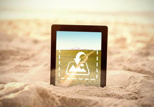 Tablet Stuck in the Sand Mockup