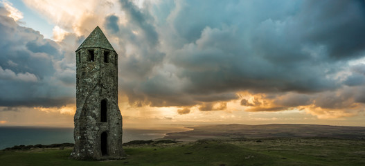 Medieval Lighthouse with approaching rain at Sundown, on the Isle of Wight