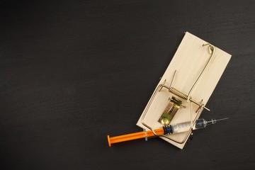 Mousetrap with sirynge. Drug addiction. Drug trap.