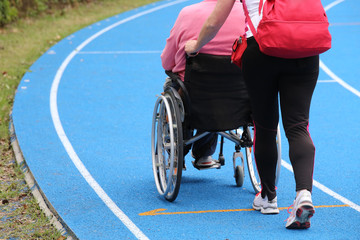 Mobility wheelchair  on the athletic track during the sporting e