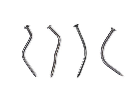 Set of Bent Construction Nails on a White Background