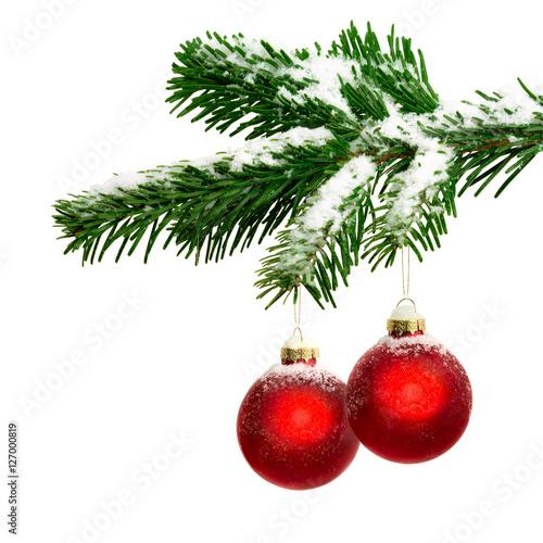 zwei christbaumkugeln h ngen an einem tannenzweig. Black Bedroom Furniture Sets. Home Design Ideas