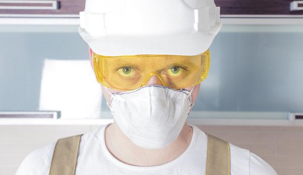 Worker wearing safety glasses respirator helmet