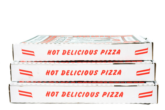 Stack of closed pizza boxes. Vertical.
