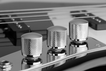 knobs of tone control on electric bass guitar