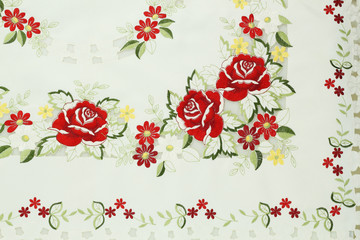 White cotton fabric in embroidery roses pattern for background o
