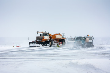 Snowplows cleans the runway