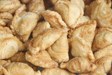 Stock Photo:.spinner curry puffs on detail