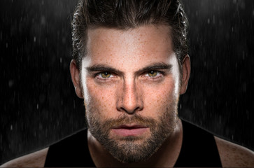 Intense eyes stare powerful expression determined focused conviction from masculine athlete rain Wall mural