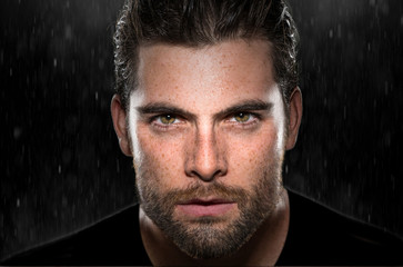 Handsome attractive dark intense eyes passionate intensity powerful stare strong sexy man in rain - fototapety na wymiar