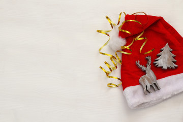 Santa claus hat next to decorations on white background