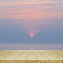 Perspectve Wood Table and Blurred Sunrise Background.