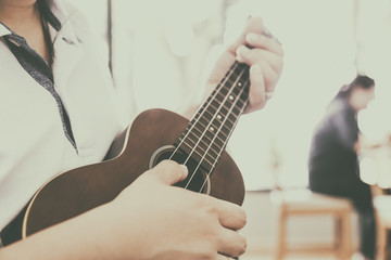 woman handicraft playing ukulele