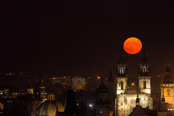 Full moon between towers of Church of Our Lady before Tyn, Prague, Czech Republic