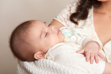 mother with sleeping baby portrait, happy maternity concept, yellow toned