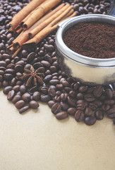 coffee beans on brown paper background, over light and retro tone