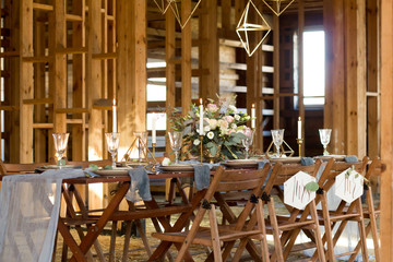 Decoration wedding table before a banquet in a wooden barn.