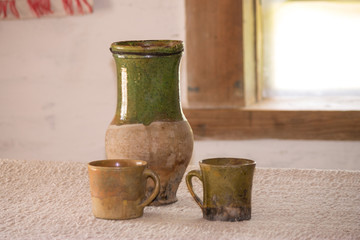 Clay jug and cups