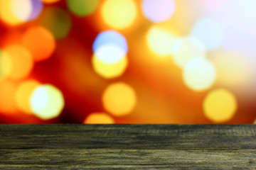 Wall Murals Christmas background with empty old dark wooden desk table. Colorful holiday bokeh lights. Selective focus on wood foreground and ready for product montage. White copyspace on top corner.